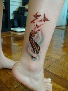 Colored feather tattoo. this is pretty good, i would put it on foot.