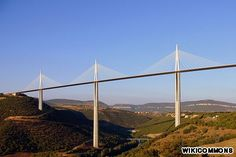 The world's highest vehicular bridge, the Millau Viaduct traverses land not water, though when the fog rolls in, crossing the Millau (Tran Valley, France)  can feel like crossing the sky.  The bridge's construction set three world records.
