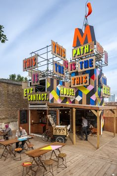 the temporary Movement Café and performance space built next to the DLR station in Greenwich, South East London by Morag Myerscough and Len Sissay.