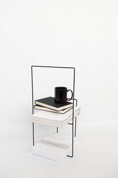 Modern metal magazine holder in black | table . Tisch  |  Design: ADesignprojects |