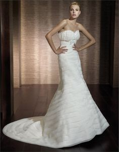 This couture wedding dress features beautiful layered bust, sweetheart shape. Simple and elegant satin tie under bust line. Fully cascading circle layered skirt. Simple style bridal gown in A line silhouette. Recommended color: White, Ivroy.
