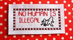 No human is illegal. Noone is illegal. Refugee crisis. Mini protest banner.