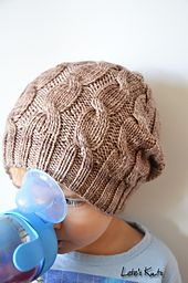 Sand Bank is a seamless slouchy hat knit from the bottom up, with simple cables.