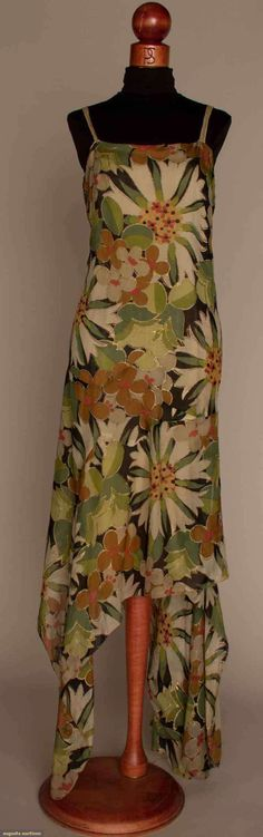 1928 FLORAL CHIFFON EVENING GOWN, Shades of green, rose, tan, cream & black, flower motifs outlined in gold paint, bias cut & exaggerated handkerchief hem, nude silk lining