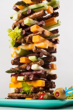 Stack the snacks, it's #FoodJenga time. See how high you can build your tasty tower. A little garnish adds a nice touch. #CabinFeverHack