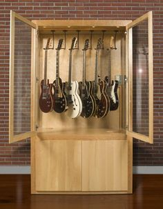 A display case presents the inner-self of the creator. With a look at the display case, you can know the person inside. There are DIY display case ideas. Guitar Display Case, Guitar Storage, Guitar Rack, Guitar Stand, Display Cases, Home Music Rooms, Home Studio Music, Guitar Cabinet, Studio Room