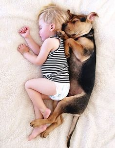 Spooning.  Adorable Toddler and His Puppy Continue Napping Together - My Modern Metropolis