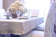 Beneath the Magnolias: How to Make a Burlap Slipcover Tablecloth - oooh!! Making this for both tables - out of the drop cloth I have left over from slip covers - LOVE!