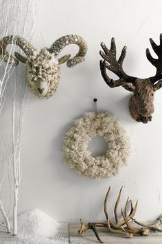 diy pom pom wreath - leave ends on the pom poms and use them to fasten to a wreath frame