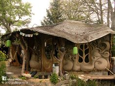 This stunningly beautiful home, with sculpted cob walls, looks out over the banks of a small stream in Somerset, England where the local dialect still has remnants of the Anglo-Saxon language. You can see more pictures of this home at www.naturalhomes.org/goatlings.htm