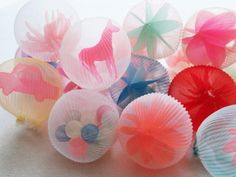 This Japanese artist handcrafts translucent fibre orbs, each with a curious object or two inside.
