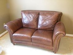 Leather Love Seat $400