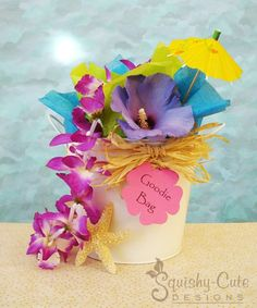 Wedding Goodie Bags for Kids - This idea would work for a tropical, beach or Hawaiian wedding theme.  Check out our list of 10 suggestions of what you could include in your wedding goody bags.