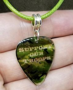 Support Our Troops Camo Guitar Pick Necklace on Green Rolled Cord – SimplyRaevyn Guitar Pick Jewelry, Guitar Pick Necklace, Military Jewelry, Support Our Troops, Guitar Picks, Stocking Stuffers, Camo, Pendant Necklace, Green