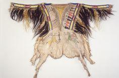 Man's shirt, Northern Tsitsistas/Suhtai (Cheyenne), hide, porcupine quills, glass beads, human hair, horsehair, sinew, tree pitch and paint. Wyoming, circa 1860
