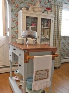 Love this kitchen so much! The wallpaper is so pretty! And I Iove the island made from a vintage desk.