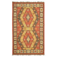 Anchor your living room seating group or patio dining set with this artful rug, featuring a fringed edge and kilim-inspired motif in brown.J/M40.