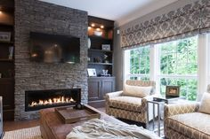 Glorious Stone Fireplace decorating ideas for Bewitching Family Room Traditional design ideas with brown ottoman built-in bookcase built-in cabinets built-in shelves dark wood cabinets gray Stacked Stone Fireplaces, Linear Fireplace, Fireplace Surrounds, Fireplace Design, Fireplace Ideas, Fireplace Stone, Modern Fireplaces, Fireplace Wall, Fireplace Pictures
