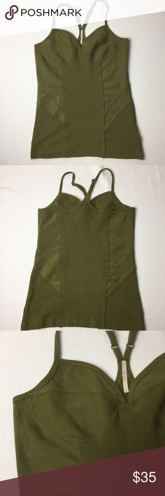 50%OFF Bundles! FREE PEOPLE Olive Green Cami Sz M Army green multiple style fabric cupped design V neck with a racer back. Raw edge hem. Camisole spaghetti strap. Gently used no stains or rips. Offers always welcome✔️Bundle for a discount✔️ Free People Tops Camisoles