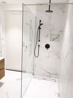 Marble Bathroom Wet Room Marble Feature Bathroom Full Height Carrara Shower Niche Modern Small Bathroom Small Bathrooms Perth WA bathroom ideas marble Marble and Black Bathroom White Marble Bathrooms, Modern Small Bathrooms, Marble Showers, Modern Bathroom Design, Bathroom Interior Design, Bathroom Black, Carrara Marble Bathroom, Small Bathroom With Bath, Marble Room