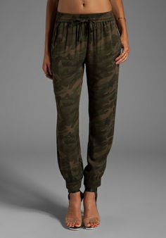 """Camo pants option featured in """"How to Wear Camo"""" LOVERS + FRIENDS for REVOLVE Smocked Trouser in Camo - New"""