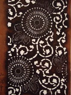 Paper stencil of chrysanthemum arabesque found at the old dyeing store in Muromachi, Kyoto. Signature of Yamanaka Sonzaburou, a stencil maker in Ise Shirako,  is written with a brush and sumi ink. This was made about 125 years ago.