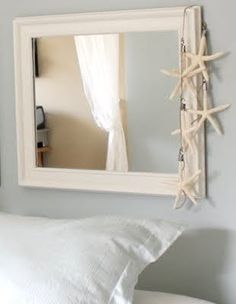 CUTE! I need to get some starfish to hang off my bedroom mirror like this.