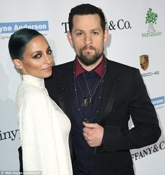 Stylish pair: Television personality Nicole Richie - who is  a board member of the organization - attended with her husband musician Joel Madden