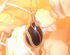 Wire wrapped blue goldstone sparkle by DragonflyHJewellery on Etsy