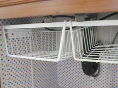 Ingenius way to add more storage under the sink.