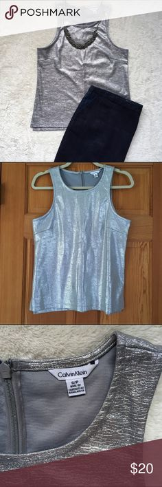 "Calvin Klein metallic textured top Metallic texture tank top, size small/petite but fits like a normal small (measure 23"" from shoulder to hem). Zips in the back. Perfect for fun occasion to add some pop to your outfit. Fits well over pants or skirts. Never worn, NEW condition! Calvin Klein Tops Tank Tops"