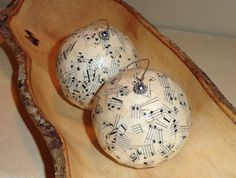 Shabby chic lightweight ornaments are covered with a mosaic pattern of vintage sheet music and just a little sparkle.    The sheet music pieces have been decoupaged to a styrofoam ball and then covered with a glossy varnish and some glamour dust. A silver bead is inserted through the top for a decorative touch.