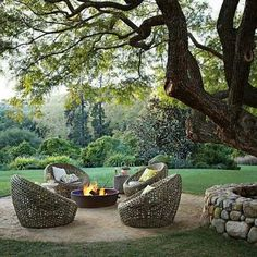 Summer style!! Outdoor modern contemporary seating on a pea gravel patio with a firepit!