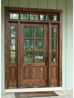 6 8 single knotty alder door w sidelights and transom clear beveled glass photographed by square top doors farmhouse exterior modern front styles Wooden Front Doors, The Doors, Panel Doors, Screen Doors, Front Doors With Windows, Transom Windows, Knotty Alder Doors, Knotty Alder Cabinets, Dark Cabinets