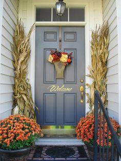 Fall Decor for a Narrow Entryway - Tie together bundles of dried up corn stalks on either side of the door, accent with fall flowers (or pumpkins!)