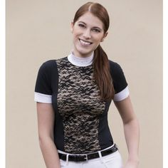 The Equi-Theme Dentelle Short Sleeved Ladies Competition Shirt is made in stretch cotton and has a high white neck decorated with strass and zipped at the rear.