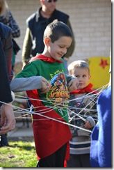 """Spider web party game - great for a Spiderman or Super Hero party. Take a ball of yarn and have kids throw it around until everyone is caught in the """"web"""". Then try to get out."""