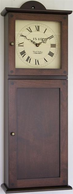 Amish Shaker Wall Clock with Storage Go back in time with the simple nature of the Amish Shaker Wall Clock emitting an Old World charm.
