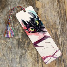 Bookmark-Toothless from Katy Lipscomb This+bookmark+features+our+newest+and+highest-quality+bookmark+style:+a+rigid,+high+resolution+lamination+print+with+rounded+edges. Creative Bookmarks, Cute Bookmarks, Bookmark Craft, Bookmark Ideas, Watercolor Bookmarks, Watercolor Art, Toothless Dragon, Dragon Party, How To Train Dragon