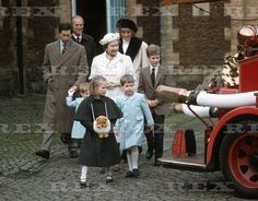 January 3, 1988: Prince Charles, Princess Diana with Queen Elizabeth & Prince Phillip watching Prince William and Prince Harry play on a 1939 Merryweather Fire Engine at the Royal Mews after Church in Sandringham.