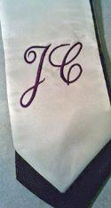 Purple and cream cursive monogram.