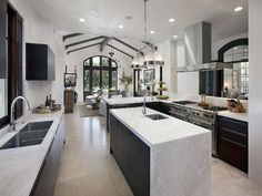 Modern Mediterranean: Black and White Kitchen  I like this. Nice floors.