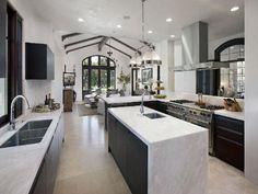 Modern Mediterranean: Black and White Kitchen  I like this. Nice floors.