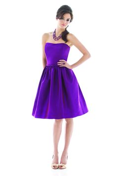 Strapless cocktail length peau de soie dress w/ matching skinny belt and pockets at side  seams of full shirred skirt. Also available full length as style d487.