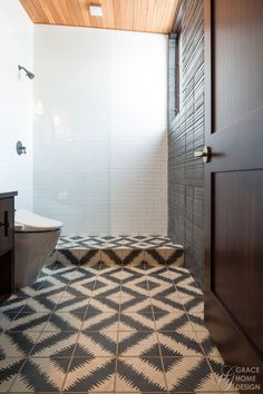 The black and white Zig Zag tile from #Ann #Sacks was the launching pad for my vision for this space.  Mixed with elegant high gloss tile, masculine Clodagh wall tile and hints of leather & brass this bathroom is timeless, unexpected and a bit magical.