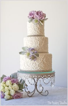 Vintage Chic Scrolled Wedding Cake with Soft Lavender & Green Garden Florals