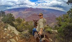 Robert Condella and his mule take in the view at the South Rim of the Grand Canyon. Take epic selfies with your GoPro camera by mounting it to the 3-Way mount . Used as a camera grip, extension arm or tripod.  See more at: http://shop.gopro.com/mounts/3-way/AFAEM-001.html#/start=1