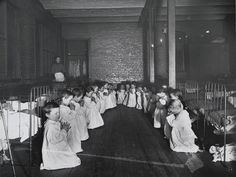 Children praying in the nursery in Five Points House. Five Points was one of the most notorious slums in New York Print Framed, Poster, Canvas Prints, Puzzles, Photo Gifts and Wall Art. Ships from UK Lower East Side, Fine Art Prints, Canvas Prints, Framed Prints, Black Hole Of Calcutta, Prayer Times, Slums, Photojournalism, Heritage Image