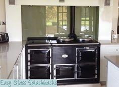 Svelte coloured glass splashback in a White Kitchen behind an Aga. Visit easyglasssplashbacks.co.uk to discover more.