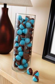I painted my acorns 2 shades of blue and added some orange ones. I displayed them in a 5 inch glass container. Unlike the tutorial, I didn't paint them all white first, nor did I paint the tops. Someday I'll figure out how to post pics of the things I mak